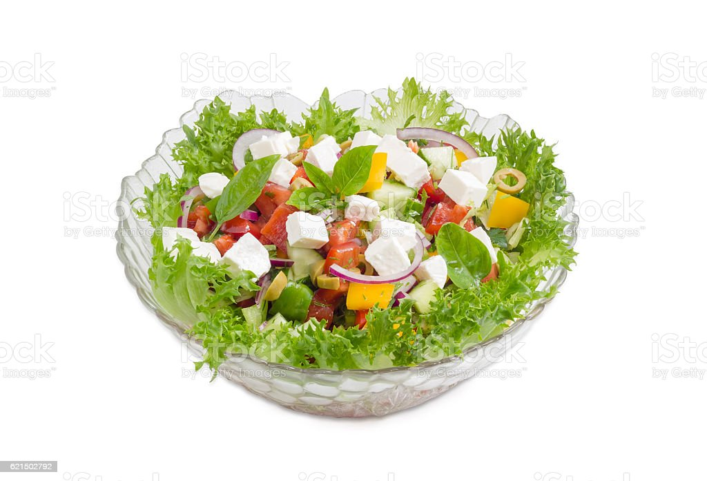 Greek salad in glass salad bowl on a light background foto stock royalty-free