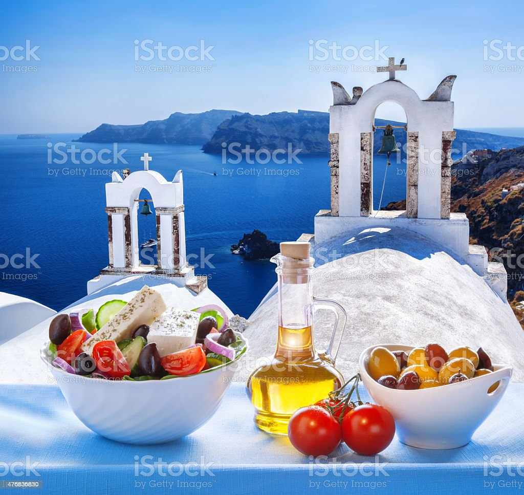 Greek salad in Santorini island, Greece Greek salad in Santorini island against famous windmills, Oia, Greece 2015 Stock Photo