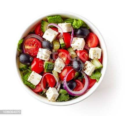 Greek salad in paper bowl for take away, isolated on white background, top view