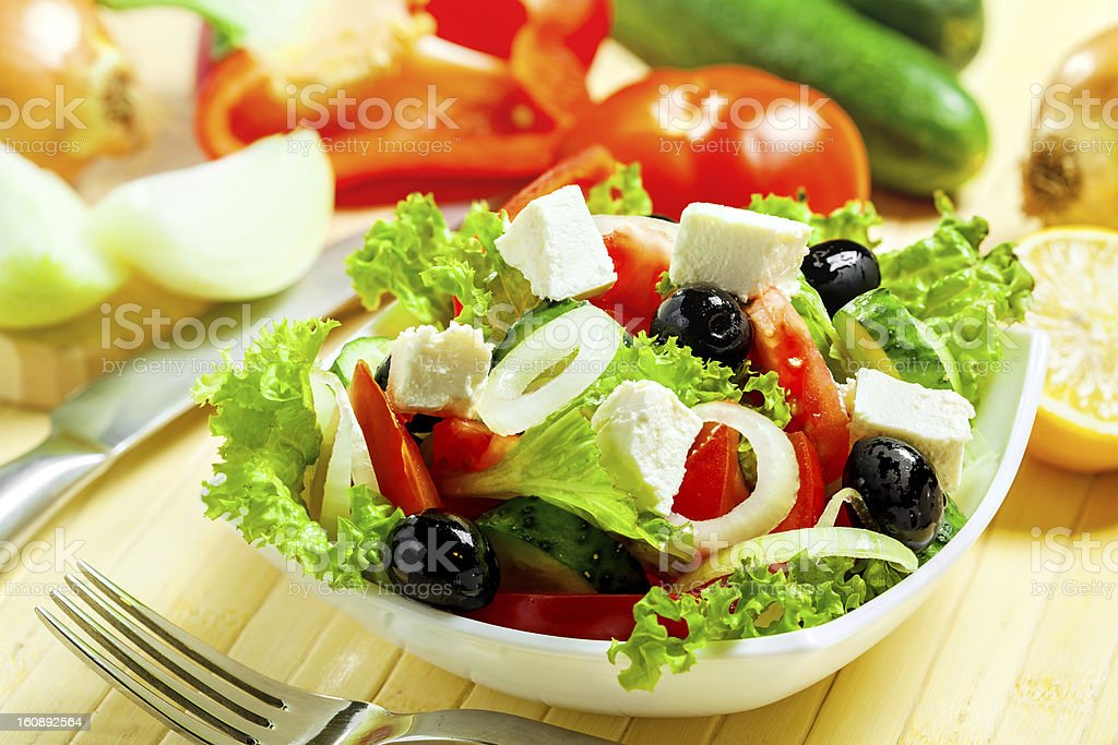 Greek salad in white bowl with olives stock photo