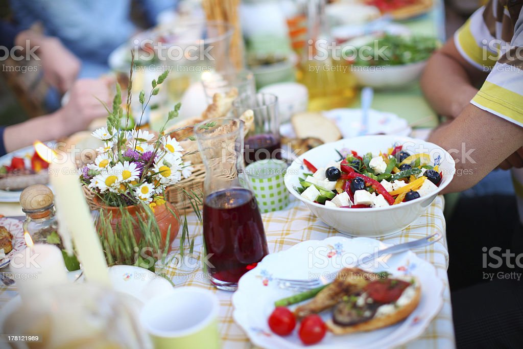 Greek salad, olives and feta cheese, picnic table with food stock photo
