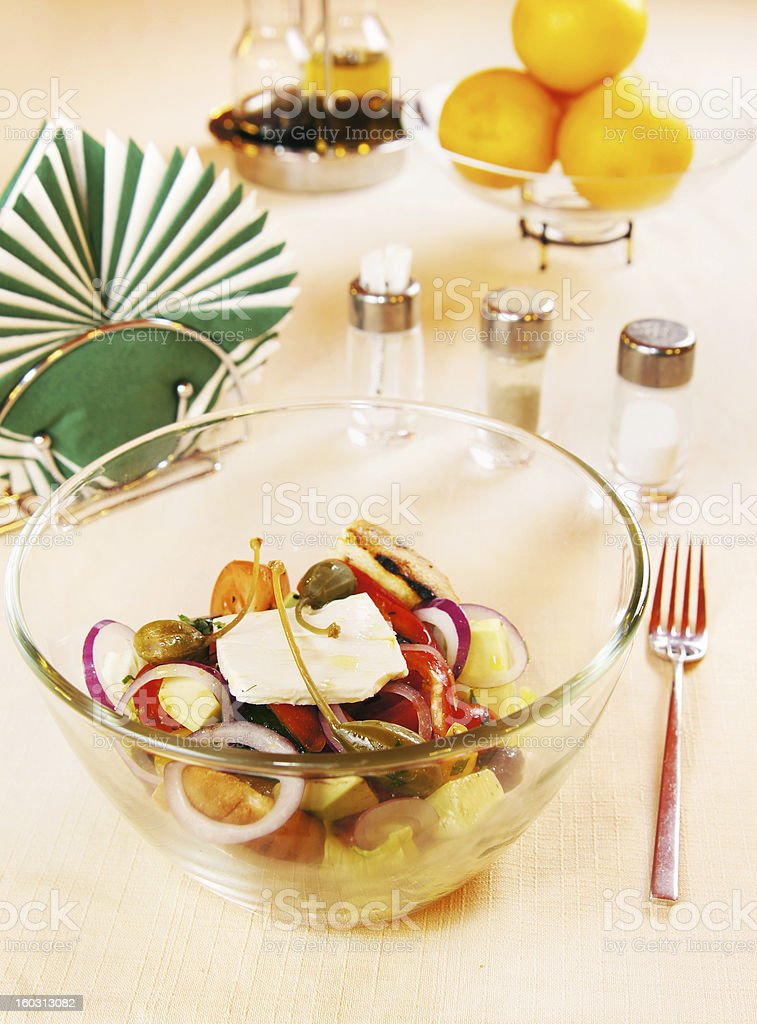 Greek salad on a laid table royalty-free stock photo
