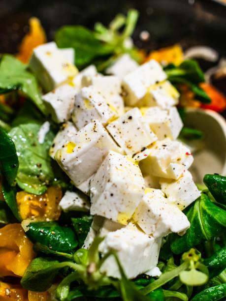 Greek salad on black background stock photo