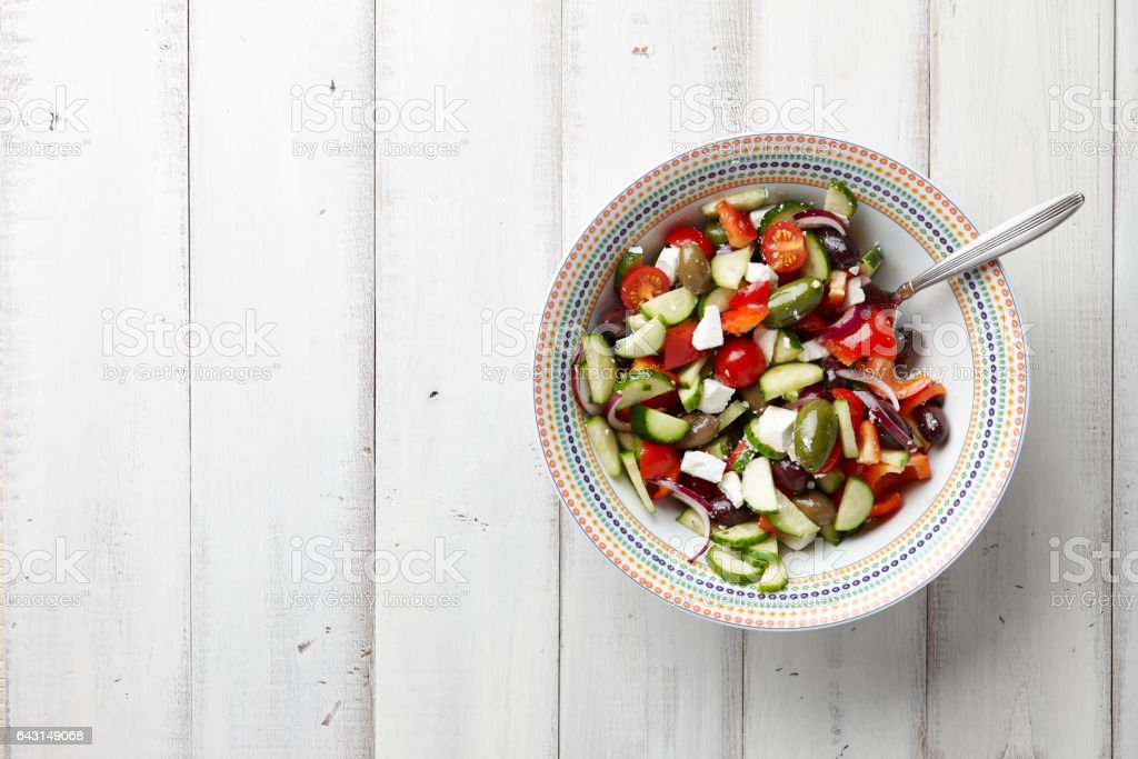 Greek salad on white wooden background stock photo