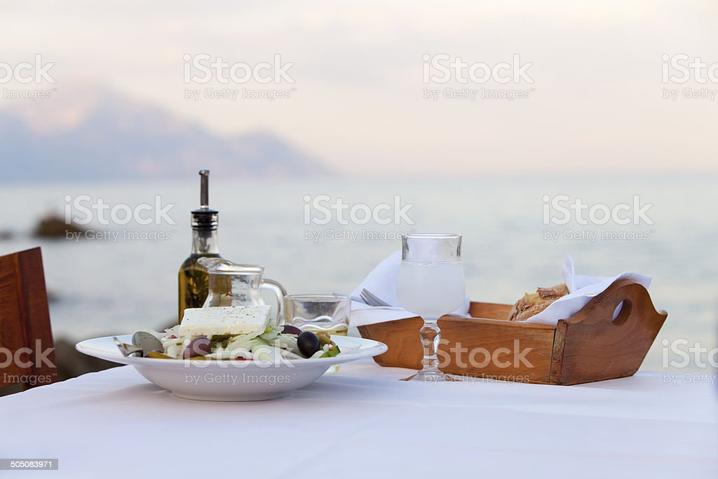 greek salad outdoors and the sea stock photo