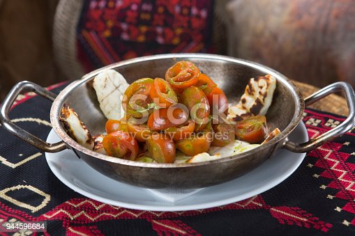 879977192 istock photo Greek Salad plate, fresh tomato and roasted White cheese. 944596684