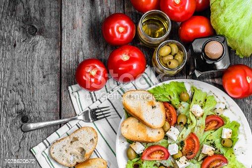 Greek salad, vegetable salads, top view on plate, vegetarian food, healthy diet concept