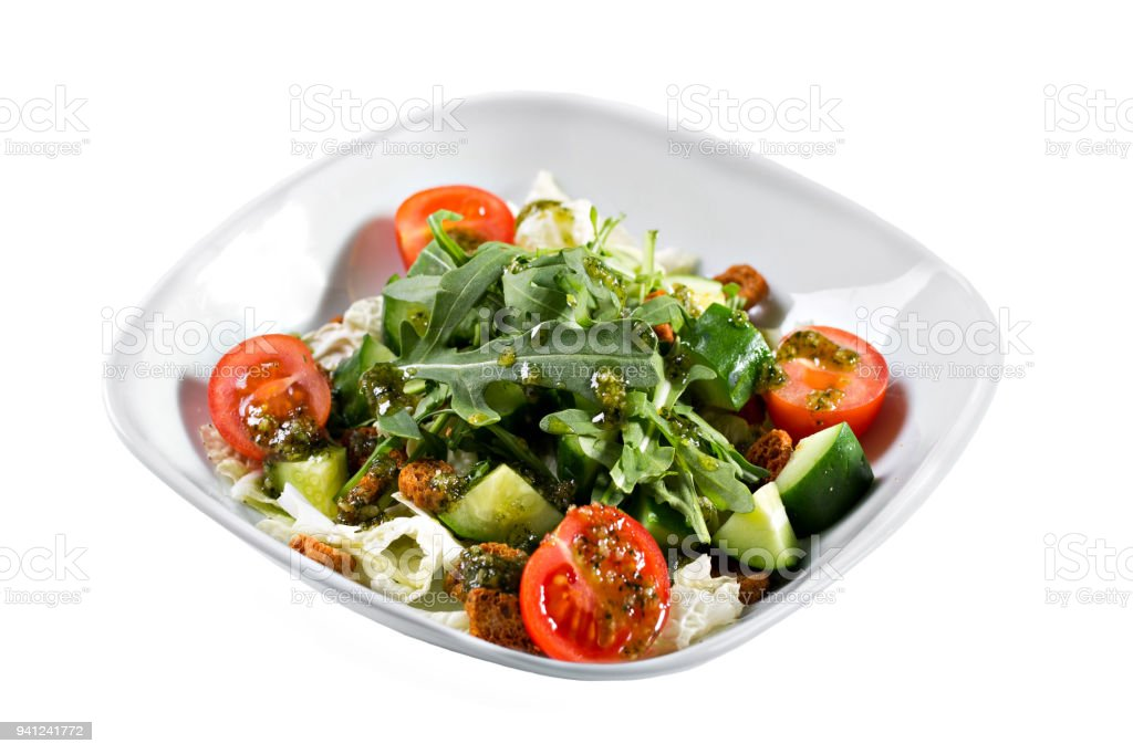 Greek salad. Vegetable with arugula leaves, green salad, with cherry tomatoes, fetta cheese, red onion, and mixed greens stock photo