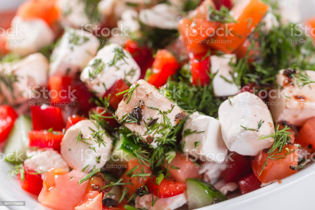 Greek salad. Vegetable with cheese, green salad, with cherry tomatoes, fetta cheese, red onion, and mixed greens stock photo