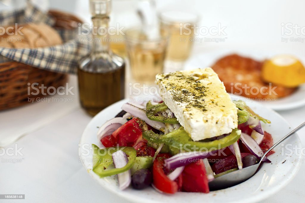 Greek salad with country bread and home made white wine royalty-free stock photo