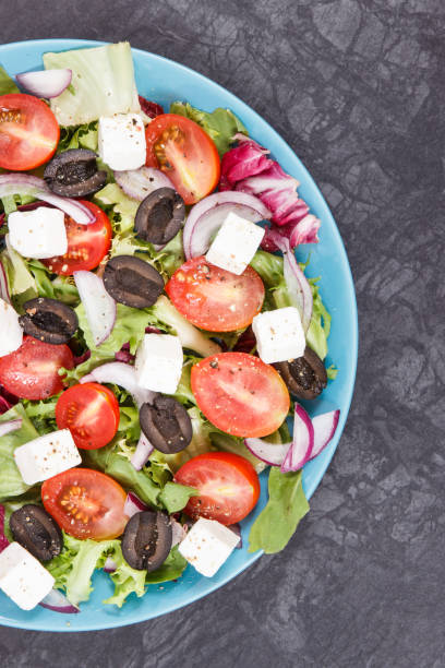 Greek salad with feta cheese and vegetables. Healthy meal as source vitamins stock photo