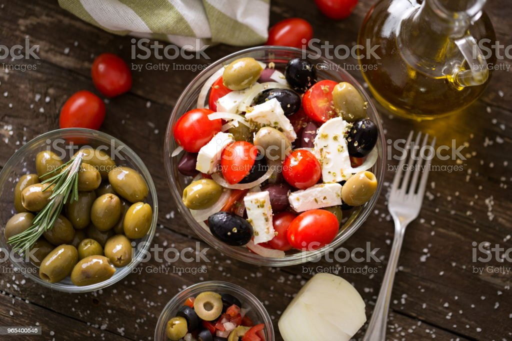 Greek salad with fresh vegetables, feta and black and green olives. Healthy fresh vegetarian food zbiór zdjęć royalty-free