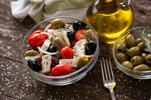 Greek Salad With Fresh Vegetables Feta Cheese And Green Olives Wooden Table Stock Photo - Download Image Now