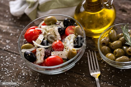 Greek Salad With Fresh Vegetables Feta Cheese And Green Olives Wooden Table Stock Photo & More Pictures of Agriculture