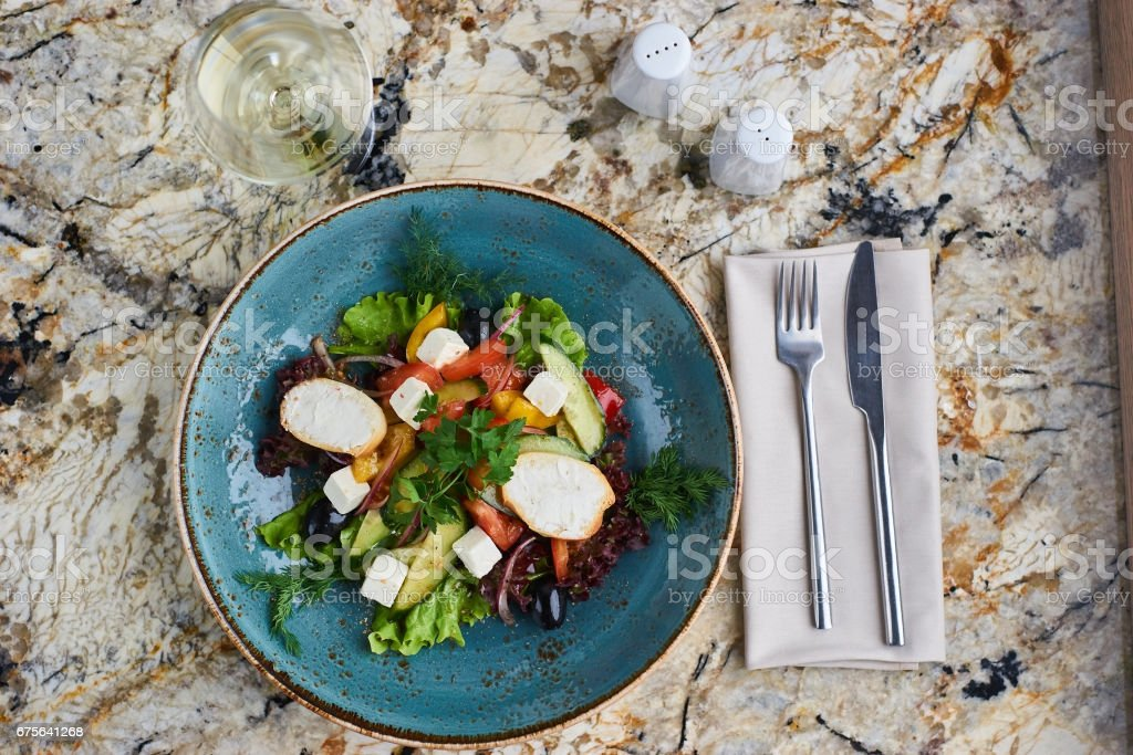 Greek salad with giant olives and provencal herbs royalty-free stock photo