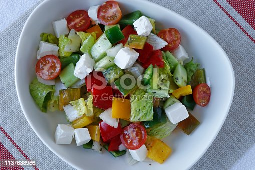 879977192 istock photo Greek salad with mixed vegetables and feta cheese 1137638986