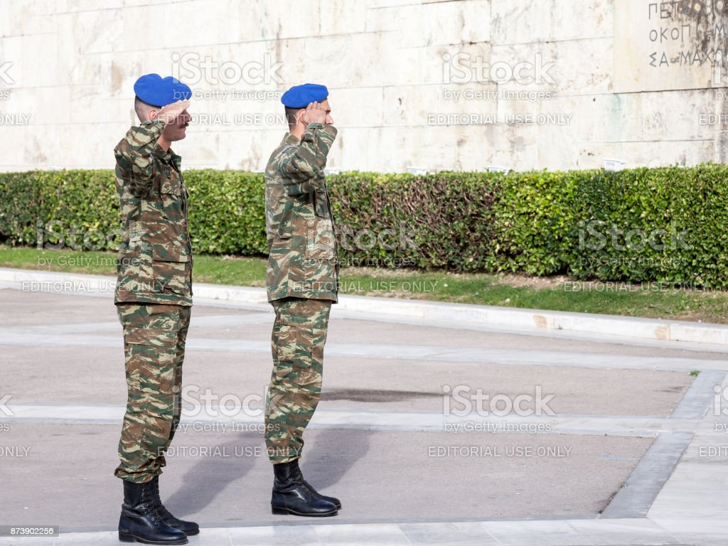 Greek solider saluting the Greek presidential guard, in front of the Greek parliament on Syntagma square. The Evzoni are one of the symbols of Greece stock photo