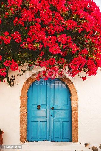 istock Greek street with Bougainvillea 1295650570