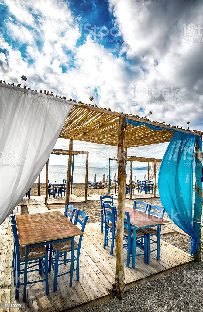 Greek tavern on beach stock photo