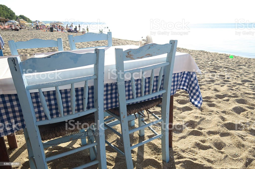 Greek tavern table by the sea. royalty-free stock photo
