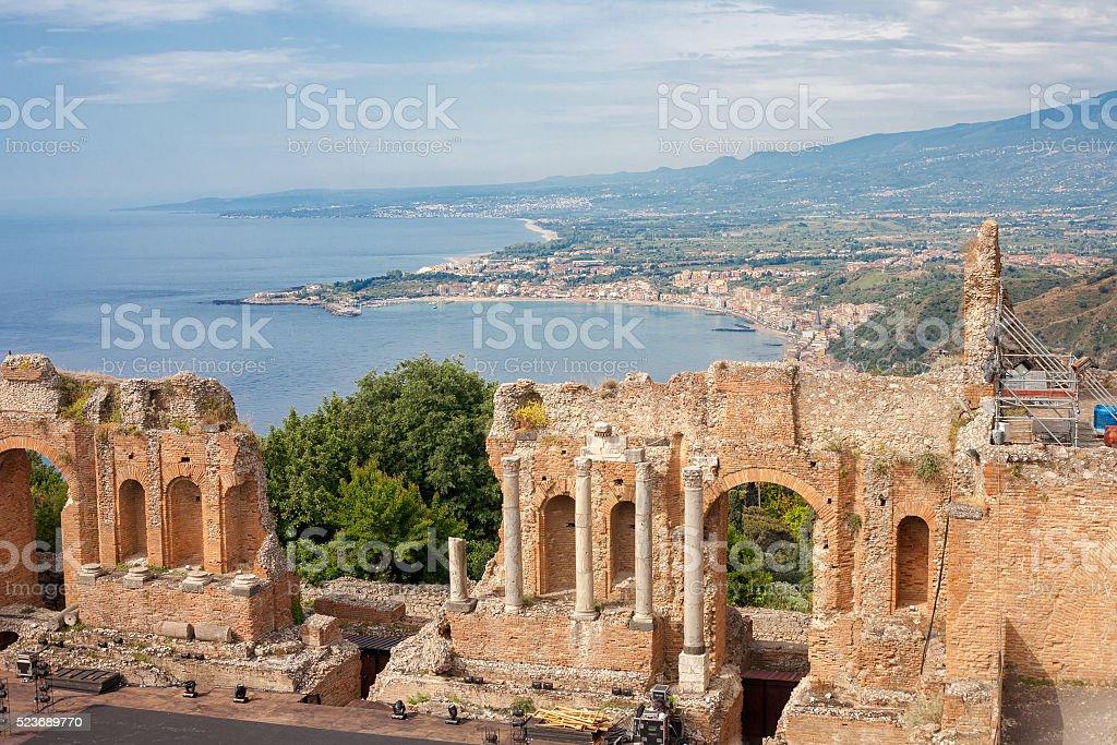 Greek theater and the Naxos bay, Taormina stock photo