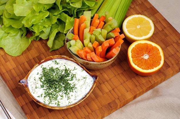 Greek tzatziki sauce and vegetable sticks stock photo