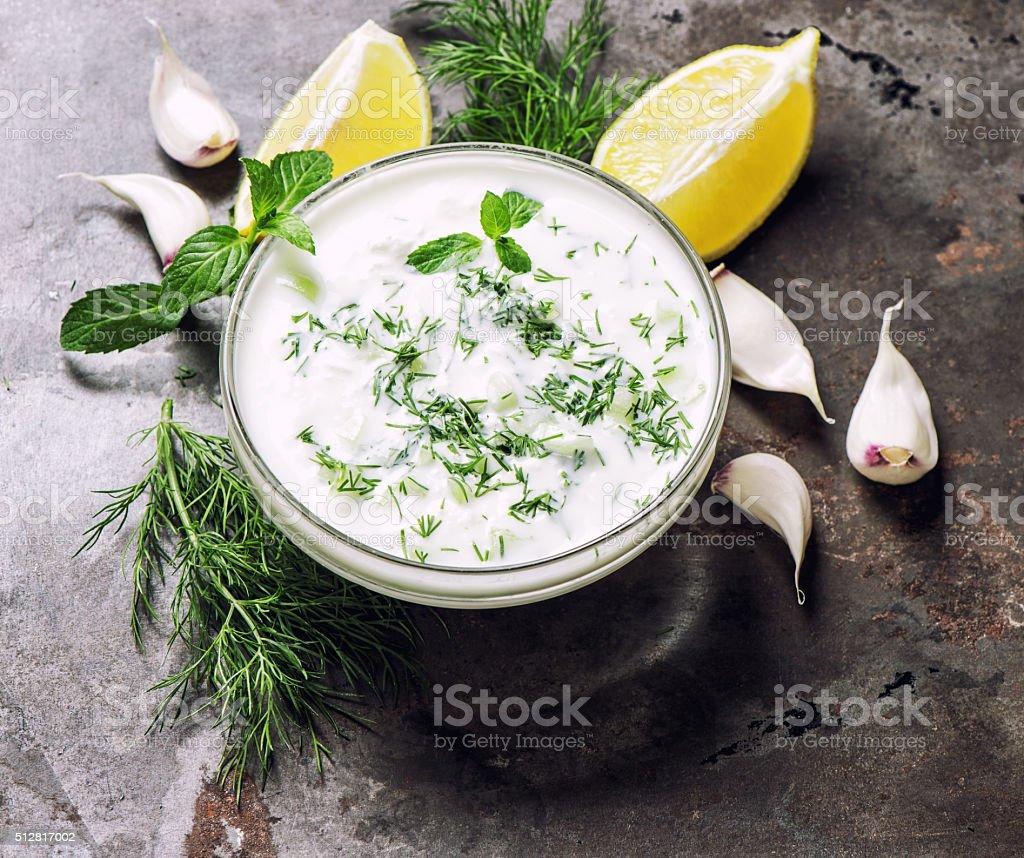 Greek tzatziki sauce. Dill, mint, garlic, lemon stock photo