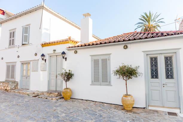 Greek white housem, Narrow traditional white street in the town of Hydra, Hydra island, Greece stock photo