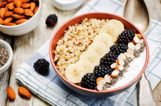 Greek yogurt almond banana Chia seeds Quinoa blackberry breakfast bowl. stock photo