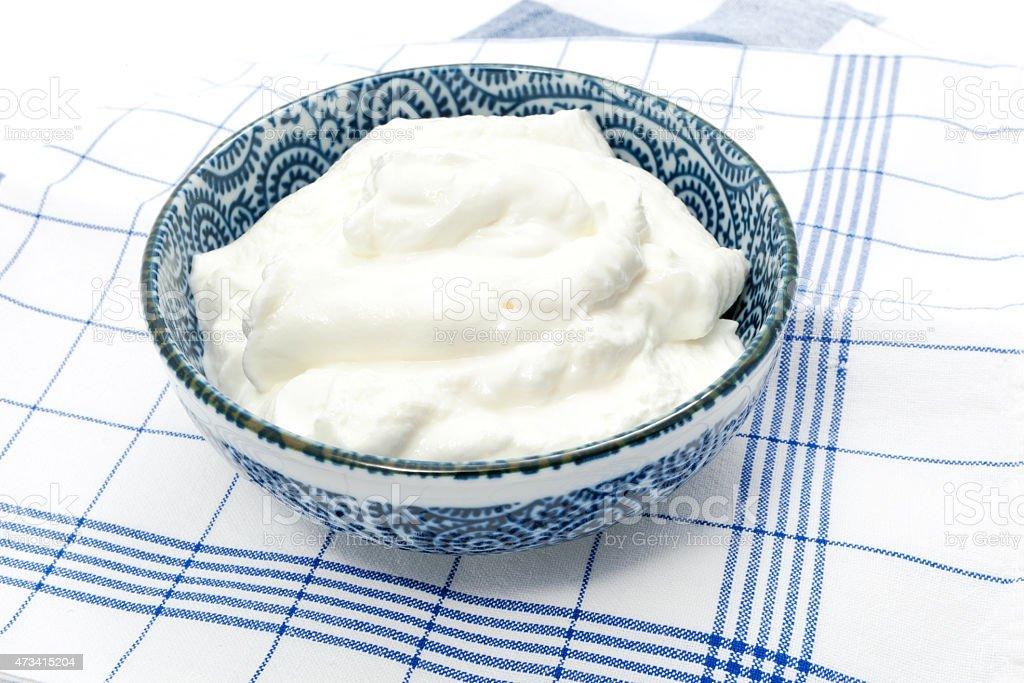 Greek yogurt in a pot stock photo