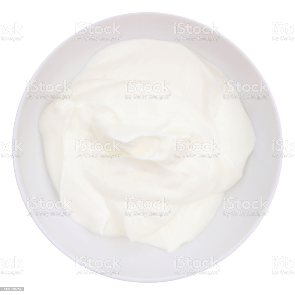 Greek yogurt in a white bowl, above view isolated on white stock photo
