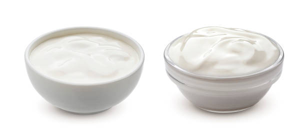 Greek yogurt in bowl isolated on white background Greek yogurt in bowl isolated on white background with clipping path sour cream stock pictures, royalty-free photos & images