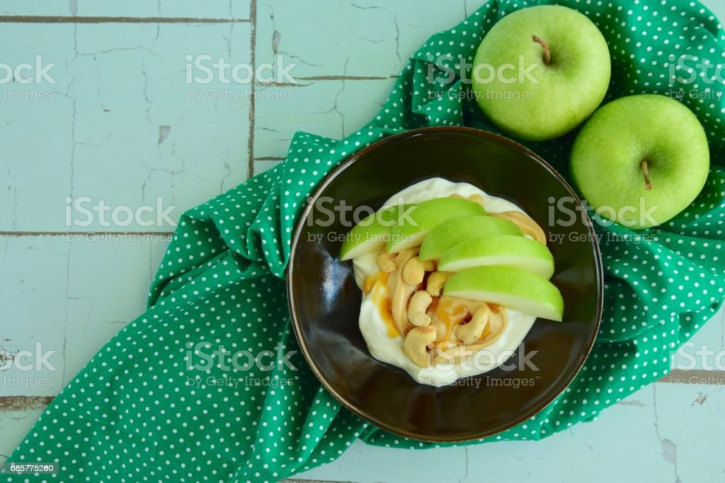 Greek yogurt with apple and cashew royalty-free stock photo
