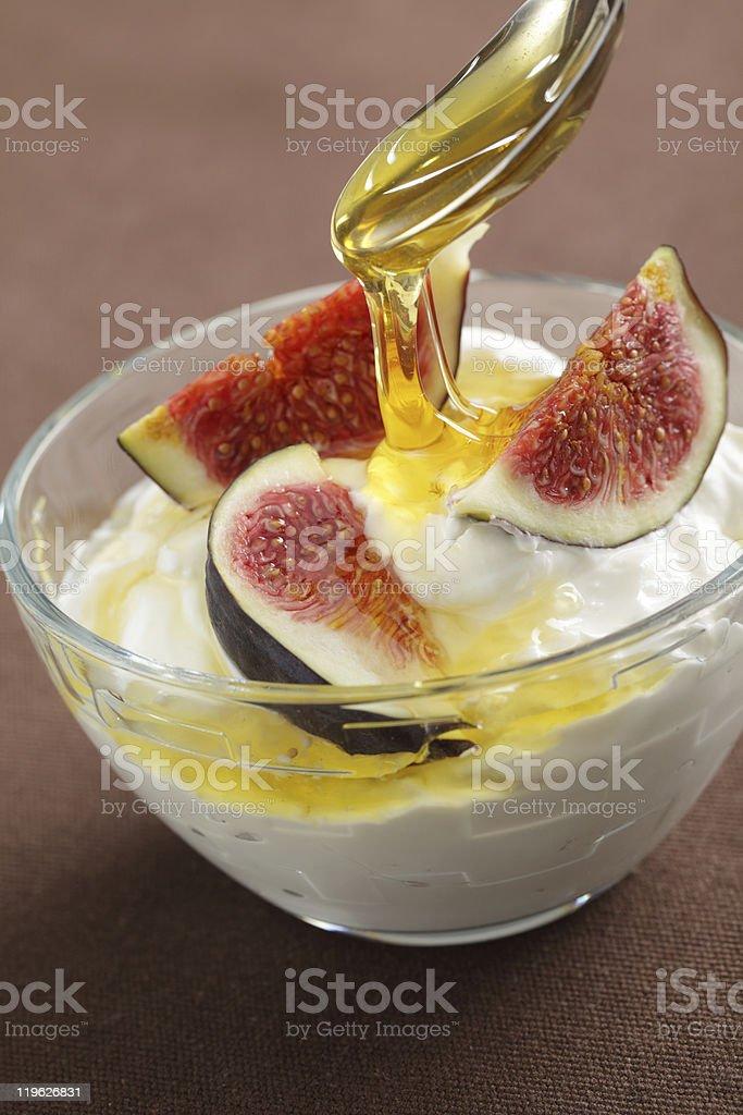 Greek yogurt with figs and honey royalty-free stock photo