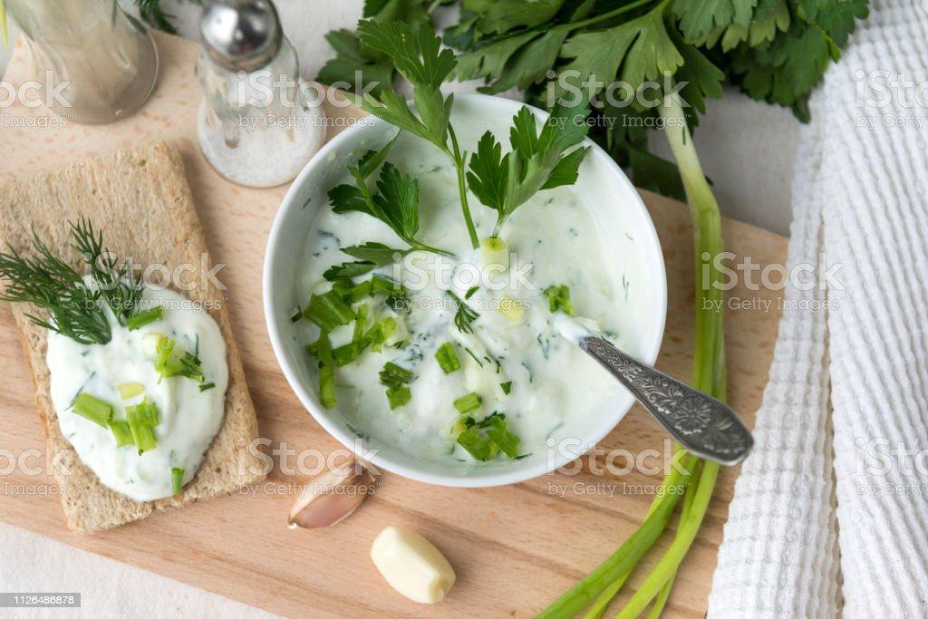 Greek yogurt with herbs, garlic, cucumber, Greek salad, Greek dish,...
