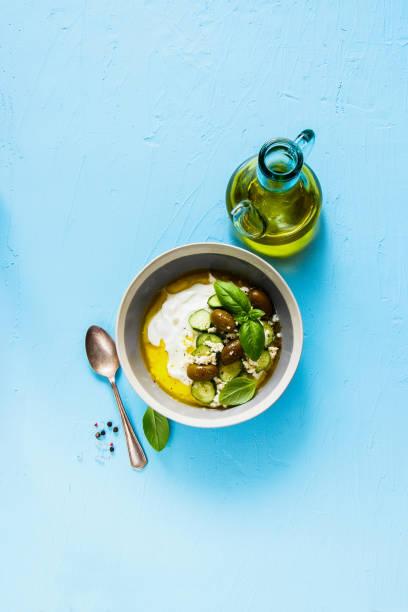 Greek yogurt with olives stock photo
