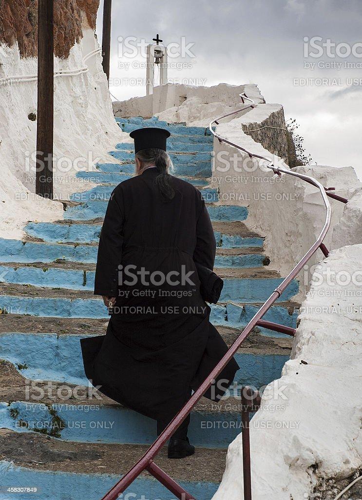 Greek-Orthodox priest on stairs stock photo
