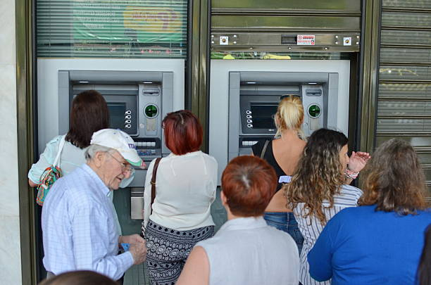 Greeks are withdrawing money from ATMs stock photo