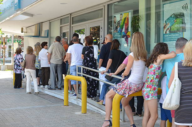 Greeks withdrawing money from ATM stock photo