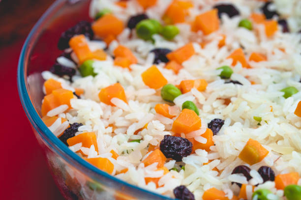 Greek-Style Rice. Brazilian dish. In this image contains rice, raisins, carrots and peas. Greek-Style Rice. Brazilian dish. In this image contains rice, raisins, carrots and peas. arroz stock pictures, royalty-free photos & images