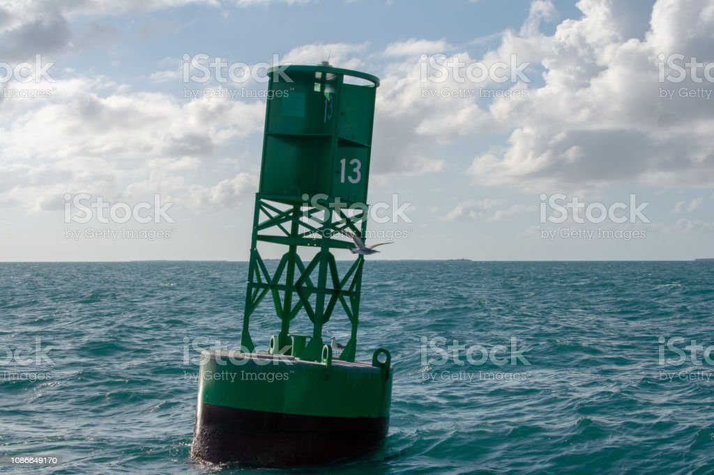 green 13 navigation marker stock photo
