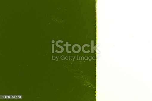 1129181821 istock photo Green Abstract film texture 1129181773