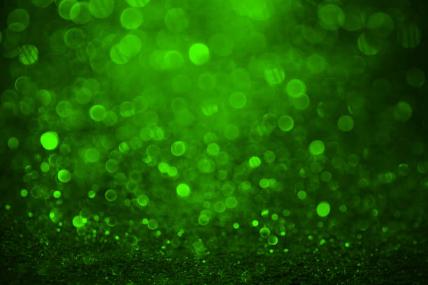 green abstract shiny background - christmas green stock photos and pictures