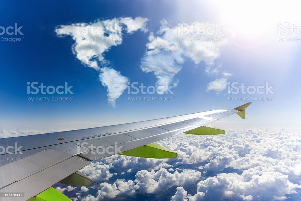 Green Air Travel Areoplane Wing World Map royalty-free stock photo