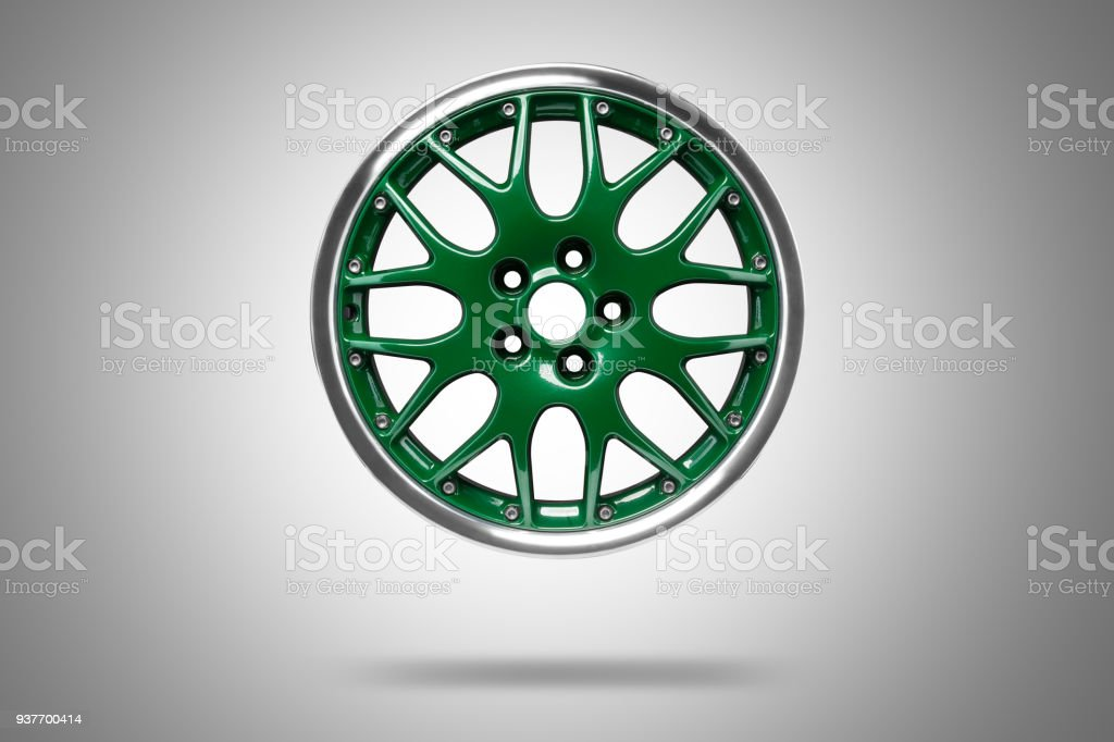 Green alloys rim at grey background stock photo