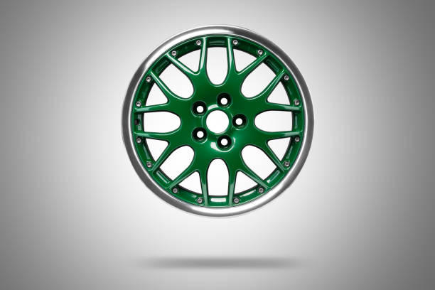 Green alloys rim at grey background stock photo