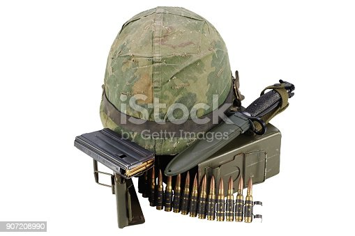 907208642 istock photo Green Ammo Box with ammunition belt and helmet 907208990