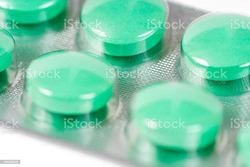 green analgesic pills in blister royalty-free stock photo