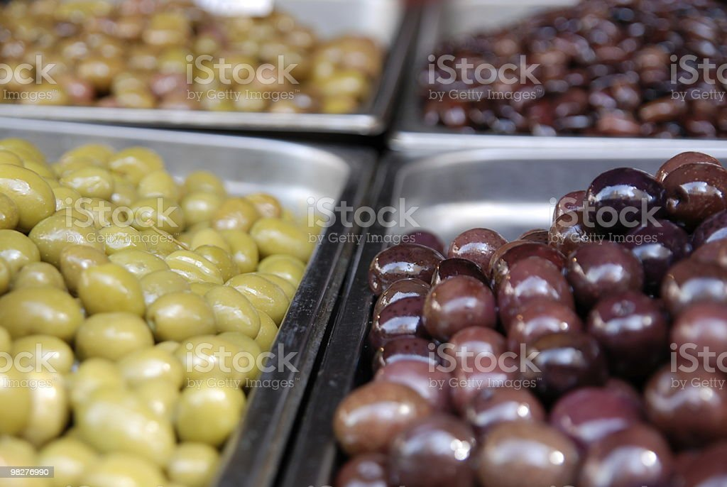 Green and black olives at a market stall in Athens royalty-free stock photo