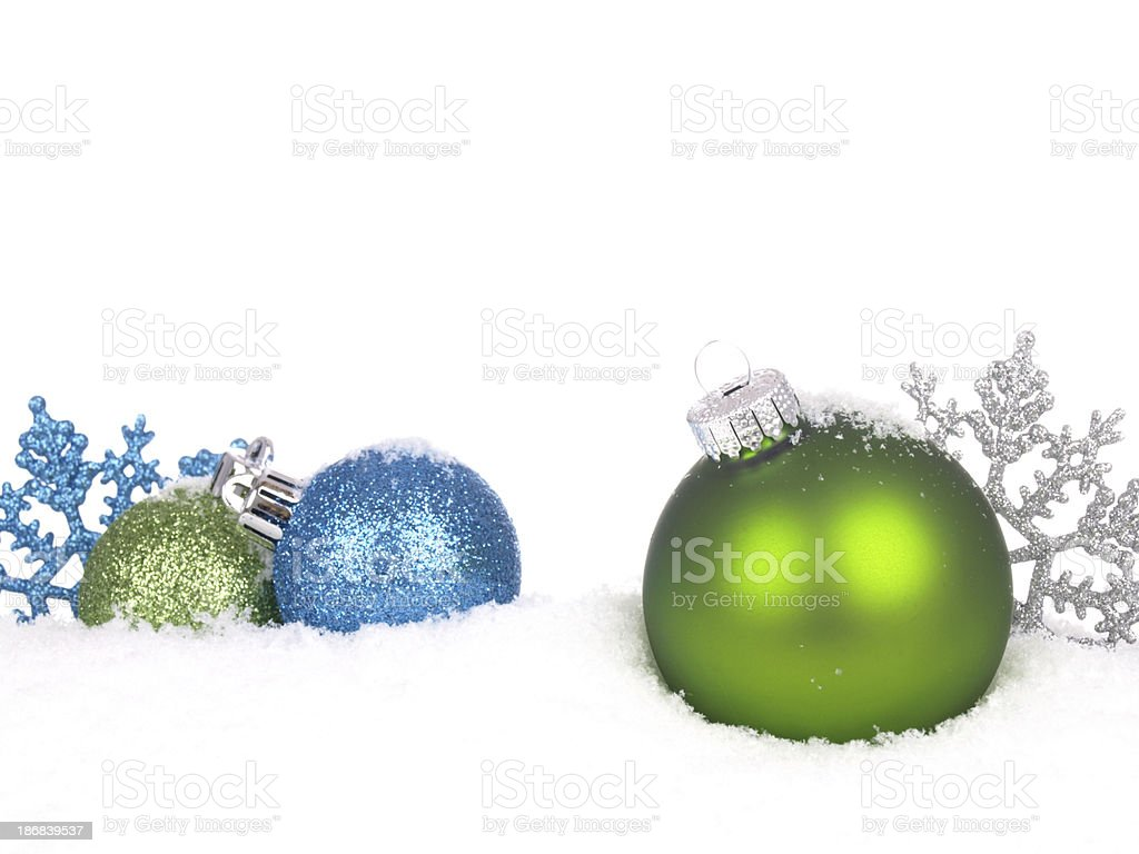 Green and Blue Baubles in Snow royalty-free stock photo